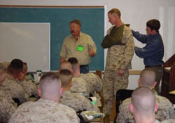 Wilderness First Responder student assisting Carl Weil, WMO's Director, doing Heavy Trauma Training for Marines on their way to Iraq